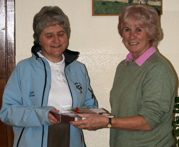 Photograph of Fiona Glass presenting gifts to Gill Smith prior to her departure on the 2013 Swedish Tour